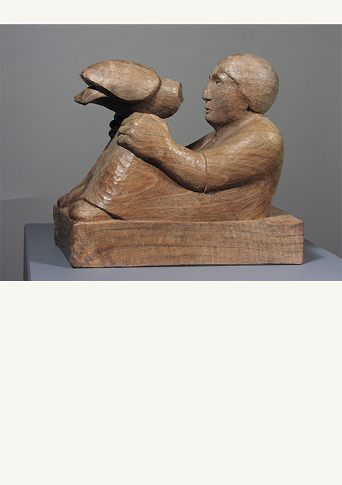 Man and Owl, sculpture by wood carver Paul Reiber
