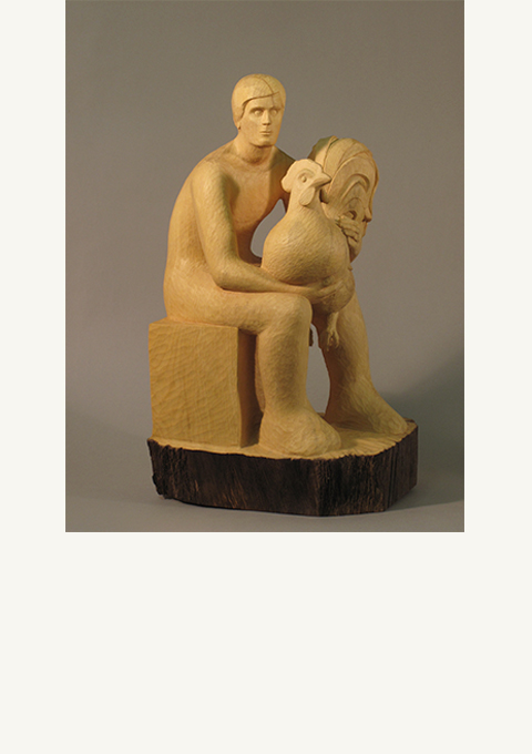 Boy with Rooster, sculpture by wood carver Paul Reiber