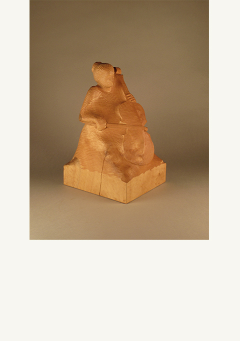 Cello Player, sculpture by wood carver Paul Reiber
