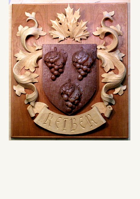 Family Crest, carved by wood carver Paul Reiber