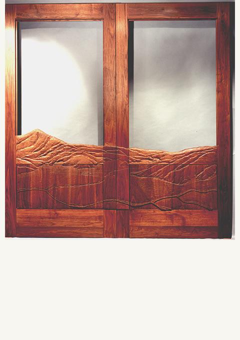 Real Goods Door, carved wooden doors by wood carver Paul Reiber