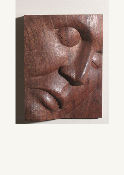 Walnut Face #3, carved panel by wood carver Paul Reiberby wood carver Paul Reiber