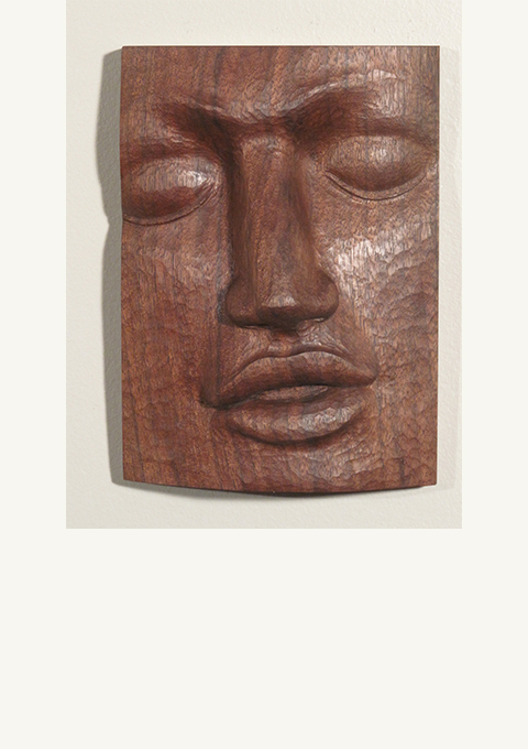 Walnut Face #4, carved panel by wood carver Paul Reiberby wood carver Paul Reiber
